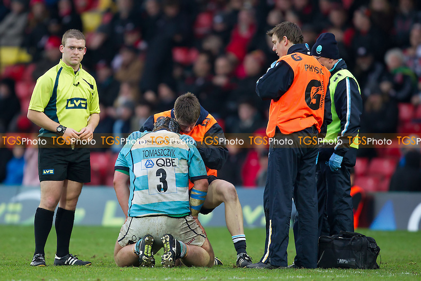 Oliver Tomaszczyk of Worcester Warriors RFC receives treatment - Saracens RFC vs Worcester Warriors RFC - LV Cup 3rd Round Rugby at Vicarage Road Stadium, Watford FC - 29/01/12 - MANDATORY CREDIT: Ray Lawrence/TGSPHOTO - Self billing applies where appropriate - 0845 094 6026 - contact@tgsphoto.co.uk - NO UNPAID USE.