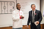 Former Wisconsin football player and Super Bowl LI Champion James White, left, announces the lineup with Head Coach Tony Granato prior to the Wisconsin Badgers NCAA Big Ten Conference hockey game against the Michigan Wolverines Saturday, February 18, 2017, in Madison, Wisconsin. The Badgers won 6-4. (Photo by David Stluka)