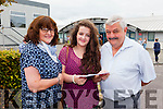 Meadhbh Lyons showing her parents Clo and Sean her Leaving Cert results at Mounthawk School on Wednesday.