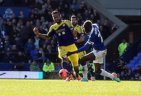 Pictured L-R: Kyle Bartley of Swansea is fouled by Lacina Traore of Everton. Sunday 16 February 2014<br />