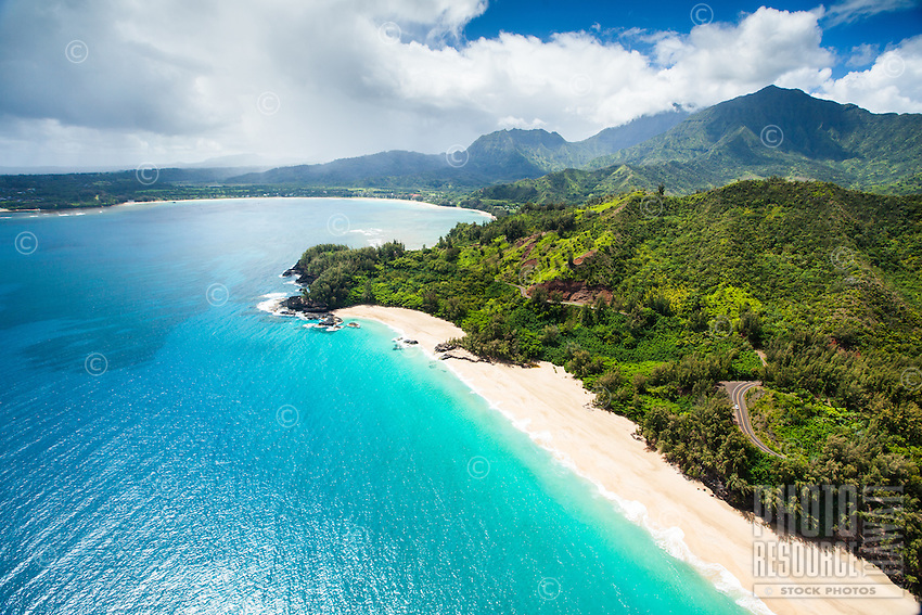 An aerial perspective of Lumaha'i Beach and Hanalei Bay, northern Kaua'i.