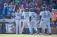 Salt River Rafters Jerar Encarnacion (27), of the Miami Marlins organization, is congratulated by Royce Lewis (9), Colton Welker (34), Victor Victor Mesa (10), and Luke Raley (25) after hitting a grand slam during the Arizona Fall League Championship Game against the Surprise Saguaros on October 26, 2019 at Salt River Fields at Talking Stick in Scottsdale, Arizona. The Rafters defeated the Saguaros 5-1. (Zachary Lucy/Four Seam Images)