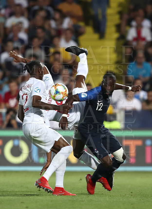 Football: Uefa under 21 Championship 2019, England - France, Dino Manuzzi stadium Cesena Italy on June18, 2019.<br /> France's Jonathan Ikoné (r) in action with England's Hamza Choudhury (c) and Aaron Wan-Bissaka (l) during the Uefa under 21 Championship 2019 football match between England and France at Dino Manuzzi stadium in Cesena, Italy on June18, 2019.<br /> UPDATE IMAGES PRESS/Isabella Bonotto