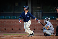 Mobile BayBears Jack Kruger (10) at bat in front of catcher Rodrigo Vigil (1) during a Southern League game against the Jacksonville Jumbo Shrimp on May 7, 2019 at Hank Aaron Stadium in Mobile, Alabama.  Mobile defeated Jacksonville 2-0.  (Mike Janes/Four Seam Images)