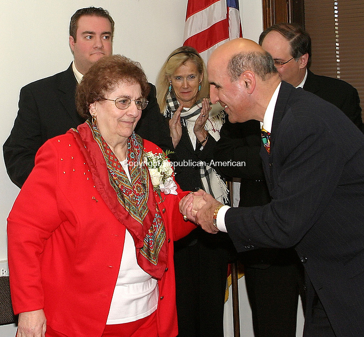 WATERBURY, CT. 21 NOVEMBER 22_NEW_112108DA01.jpg- Honorary Lebanese Mayor for the Day, Sadie A. Carrah is escorted to the podium by State Rep. Selim Noujaim during a ceremony held at City Hall in Waterbury on Friday. Standing in support from left, Carrah's grandson, Jeffrey DeFranzo, Connecticut State Senator Joan Hartley, and Waterbury Mayor Michael J. Jarjura.  REPUBLICAN/AMERICAN  Darlene Douty