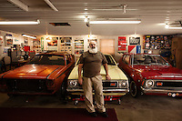 Reinholds, Pennsylvania, February 10, 2015 - A portrait of Brian Moyer in front of three of his 16 rare AMC Gremlins. Here are his (from right) 1971 Gremlin Base Model in matador red, his 1970 Gremlin Custom, and an unrestored 1974 Gremlin. <br /> <br /> Moyer owns 16 AMC Gremlins. The Gremlin was introduced on April Fools Day (April 1) in 1970 featuring a shortened Hornet body with a Kammback tail and was manufactured in the US via AMC and in Mexico via AMC's subsidiary VAM. It's lifecycle ended in 1978 when it was replaced by the AMC Spirit. Moyer became interested as a kid when he saw the early Gremlin commercials in 1970. His first car was a Gremlin and he has never not owned one. Today he has arguably the most unique collection of Gremlins in the world, including several that are one-of-a kind models. <br /> <br /> CREDIT: Daryl Peveto for The Wall Street Journal<br /> Photo Assignment ID: 36892 <br /> Slug: MYRIDE_Gremlin