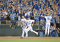 Royals team group,<br /> SEPTEMBER 30, 2014 - MLB :<br /> Eric Hosmer #35, Norichika Aoki #23 and first base coach Rusty Kuntz #15 of the Kansas City Royals celebrate after their teammate Salvador Perez (not pictured) hit the game winning RBI single in the bottom of the 12th inning during the American League Wild Card playoff baseball game against the Oakland Athletics at Kauffman Stadium in Kansas City, Missouri, United States. (Photo by AFLO)