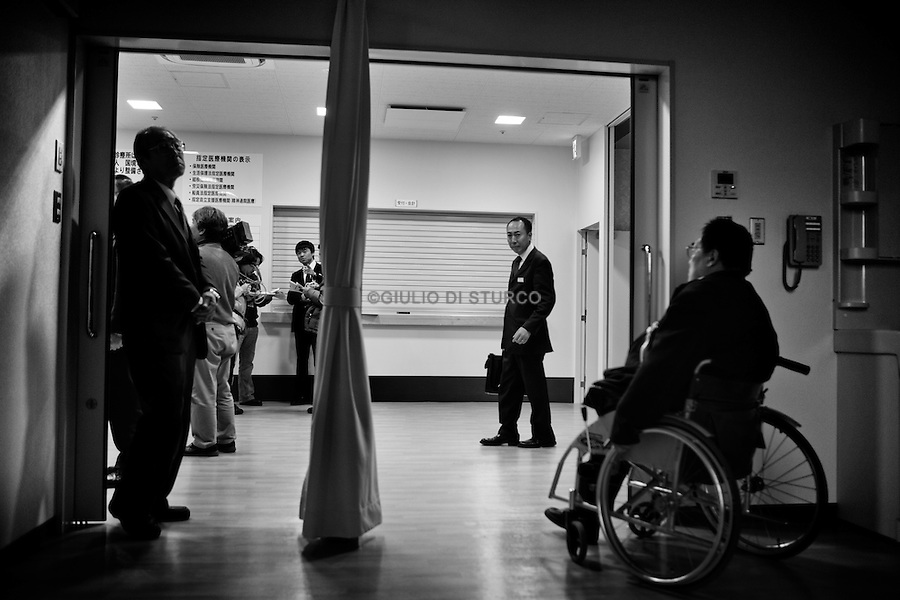 New Clinic in Taro provided by MSF, December 2011..In the north east of Japan there is a small city called Taro that was completely destroyed by the tsunami on the 3/11. After the tsunami the whole population of 8000 people moved to the top of the mountain where they settled down.  .Here they had temporary housing, temporary shops, a japanese warm bath and a temporary clinic provided by MSF. Almost one year later they are still living there, they have created their own new little community village and this has became the new reality for them. In this small colony you can find barber shops, restaurants, grocery stores, schools and a playground just like a normal village. The colony is not far from the sea so, as the majority of the population from Taro are fishermen, they don't find it too hard to survive in their new environment. From a temporary shelter this has became the new TARO Village.