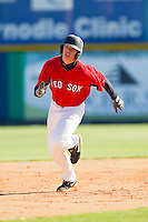 Nathan Hood (11) of Whiteville High School hustles towards third base at the 2012 South Atlantic Border Battle on November 3, 2012 in Burlington, North Carolina.  The Mets (SC13) defeated the Red Sox (NC 13) 3-2.  (Brian Westerholt/Four Seam Images)