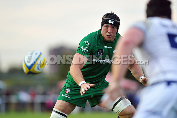 George Skivington looks to receive the ball. Pre-season friendly match, between London Irish and Bristol Rugby on August 22, 2014 at Hazelwood in Middlesex, England. Photo by: Patrick Khachfe / JMP