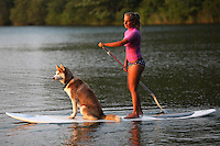 Miranda Kielpinski stand up paddle boards with her husky, Glacier, on Big Cliff Pond in Brewster. I was so struck by the sense of trust between them and by how calm Glacier seemed as they moved together over the water. Miranda's athleticism and strength in this image is so apparent and I think reflects many women's sense of empowerment through physicality.