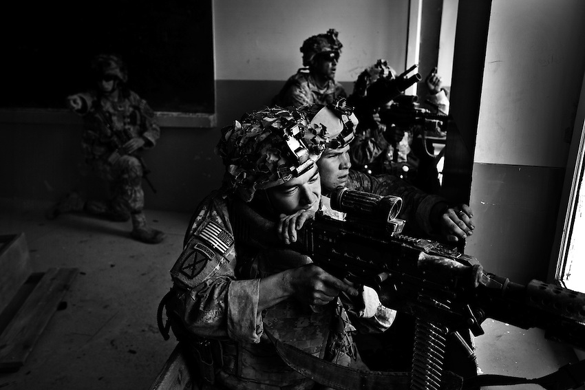 Members of Bravo Company, 1-32 Infantry, 3rd Brigade, 10th Mountain Division return fire during an ambush by the Taliban in Charkh (Logar Province), Afghanistan, Sunday, May 3, 2009. Bravo Company is based at the newly established Baugess Forward Operating Base, and frequently engage in fire fights with the Taliban during patrols. The 10th Mountain Division were the first arrivals of permanant reinforcements for the US military in Afghanistan when they arrived earlier this year.