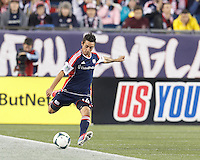 New England Revolution midfielder Diego Fagundez (14) clears the ball.  In the first game of two-game aggregate total goals Major League Soccer (MLS) Eastern Conference Semifinal series, New England Revolution (dark blue) vs Sporting Kansas City (light blue), 2-1, at Gillette Stadium on November 2, 2013.