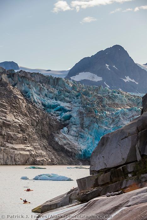 Tourists kayak amongst icebergs in Nellie Juan Lagoon, Nellie Juan Glacier, Chugach National Forest, Kenai Peninsula, Prince William Sound, southcentral, Alaska.
