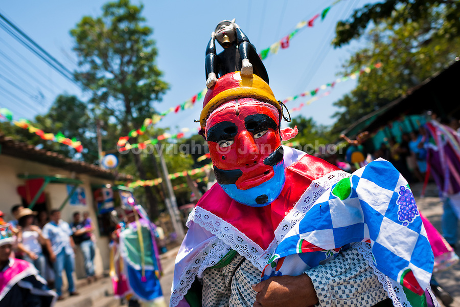 """Salvadoran men, dressed as Moors and Christians, perform the traditional dance during the Flower & Palm Festival in Panchimalco, El Salvador, 8 May 2011. On the first Sunday of May, the small town of Panchimalco, lying close to San Salvador, celebrates its two patron saints with a spectacular festivity, known as """"Fiesta de las Flores y Palmas"""". The origin of this event comes from pre-Columbian Maya culture and used to commemorate the start of the rainy season. Women strip the palm branches and skewer flower blooms on them to create large colorful decoration. In the afternoon procession, lead by a male dance group performing a religious dance-drama inspired by the Spanish Reconquest, large altars adorned with flowers are slowly carried by women, dressed in typical costumes, through the steep streets of the town."""