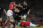 Cardiff, WALES - November 24:.Autumn International.Wales v New Zealand.All Blacks lock Sam Whitelock crashes into Toby Faletau..24.11.12..©Steve Pope - Sportingwales