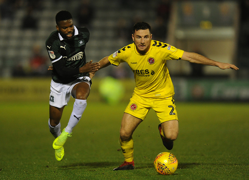 Fleetwood Town's Lewis Coyle under pressure from Plymouth Argyle's Joel Grant<br /> <br /> Photographer Kevin Barnes/CameraSport<br /> <br /> The EFL Sky Bet League One - Plymouth Argyle v Fleetwood Town - Saturday 24th November 2018 - Home Park - Plymouth<br /> <br /> World Copyright © 2018 CameraSport. All rights reserved. 43 Linden Ave. Countesthorpe. Leicester. England. LE8 5PG - Tel: +44 (0) 116 277 4147 - admin@camerasport.com - www.camerasport.com