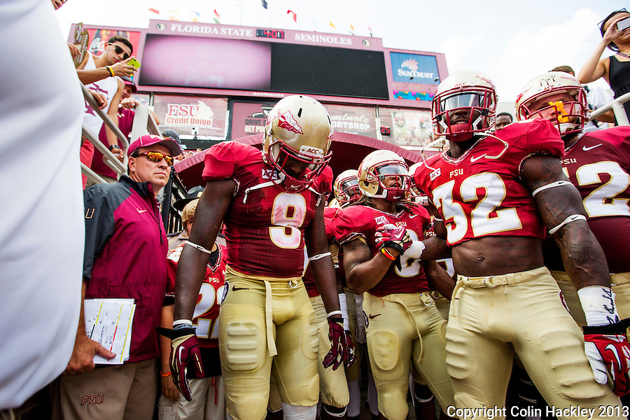 TALLAHASSEE, FLA 9/14/13-FSU-NEV091413CH-Florida State's Head Coach Jimbo Fisher, left, Karlos Williams, Devonta Freeman, James Wilder, Jr. and Bryan Stork prepare to take the field prior to the Nevada game Saturday at Doak Campbell Stadium in Tallahassee. <br /> COLIN HACKLEY PHOTO