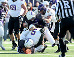 SIOUX FALLS, SD - NOVEMBER 11: Kyle Campiotti #19 and Dennis Gardeck #47 from the University of Sioux Falls bring down Ryan Schlichte #5 from Minnesota State Mankato during their game Saturday afternoon at Bob Young Field in Sioux Falls. (Photo by Dave Eggen/Inertia)