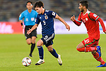 Minamino Takumi of Japan (L) is followed by Khalid Al Braiki of Oman (R) during the AFC Asian Cup UAE 2019 Group F match between Oman (OMA) and Japan (JPN) at Zayed Sports City Stadium on 13 January 2019 in Abu Dhabi, United Arab Emirates. Photo by Marcio Rodrigo Machado / Power Sport Images