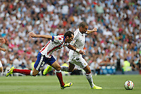 Pepe of Real Madrid and Godin of Atletico de Madrid during La Liga match between Real Madrid and Atletico de Madrid at Santiago Bernabeu stadium in Madrid, Spain. September 13, 2014. (ALTERPHOTOS/Caro Marin)