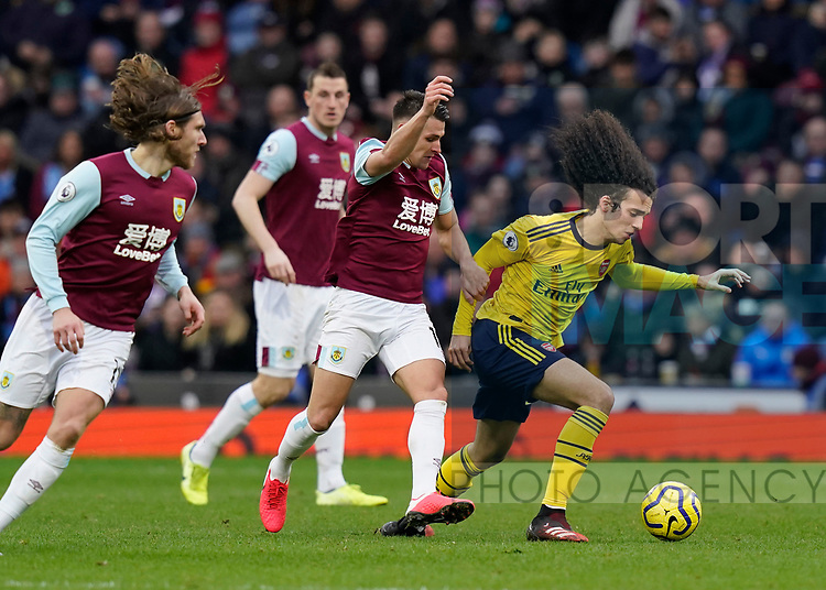 Matthew Lowton of Burnley tackles Matteo Guendouzi of Arsenal  during the Premier League match at Turf Moor, Burnley. Picture date: 2nd February 2020. Picture credit should read: Andrew Yates/Sportimage
