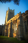 Side view of a church in evening sunlight in Eye, Suffolk, England
