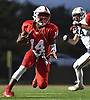 Terrance Edmond #14, Freeport quarterback, races downfield during the second quarter of a Nassau County Conference I varsity football game against Massapequa at Freeport High School on Friday, Oct. 5, 2018.