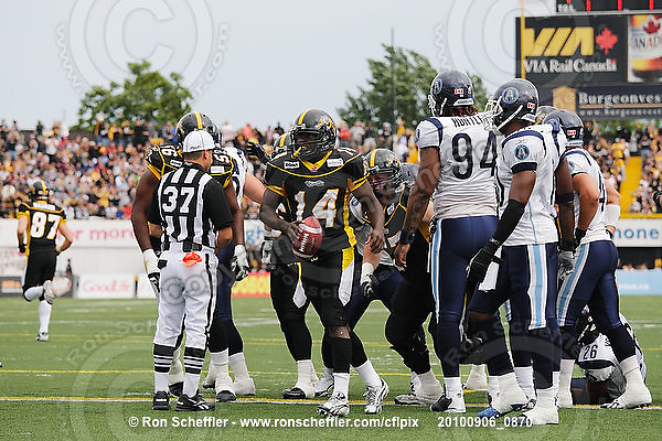 September 6, 2010; Hamilton, ON, CAN; Hamilton Tiger-Cats running back DeAndra' Cobb (14) scores a touchdown. CFL football: Labour Day Classic - Toronto Argonauts vs. Hamilton Tiger-Cats at Ivor Wynne Stadium. The Tiger-Cats defeated the Argonauts 28-13. Mandatory Credit: Ron Scheffler.