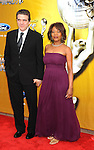 LOS ANGELES, CA. - February 26: Roderick Spencer and Alfre Woodard arrive at the 41st NAACP Image Awards at The Shrine Auditorium on February 26, 2010 in Los Angeles, California.