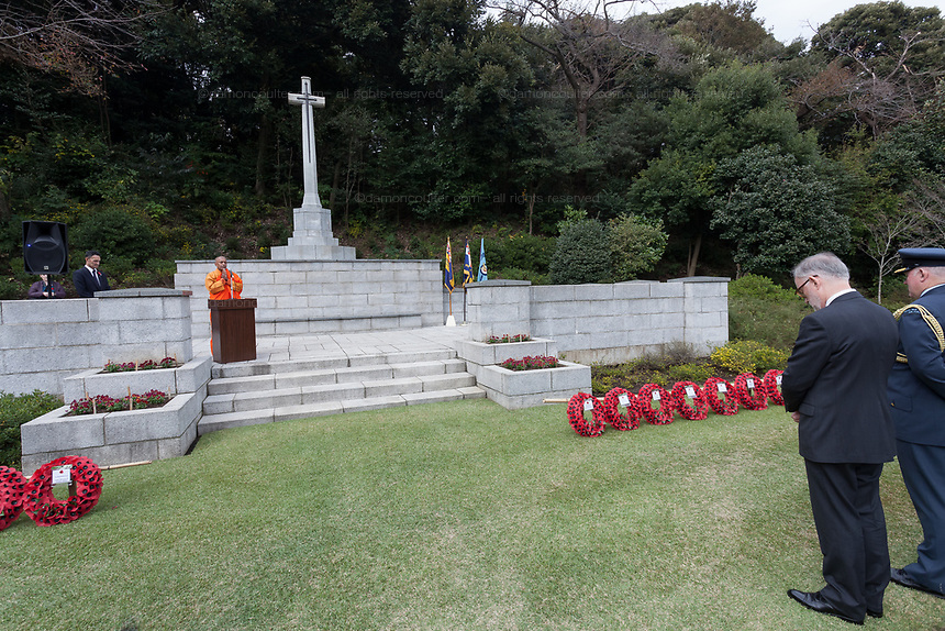 The Venerable Yatawara Pannarama gives a Buddhist prayer or remembrance and peace during the Remembrance Sunday ceremony at the Hodogaya, Commonwealth War Graves Cemetery in Hodogaya, Yokohama, Kanagawa, Japan. Sunday November 11th 2018. The Hodagaya Cemetery holds the remains of more than 1500 servicemen and women, from the Commonwealth but also from Holland and the United States, who died as prisoners of war or during the Allied occupation of Japan. Each year officials from the British and Commonwealth embassies, the British Legion and the British Chamber of Commerce honour the dead at a ceremony in this beautiful cemetery. The year 2018 marks the centenary of the end of the First World War in 1918.