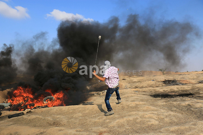 Palestinian protesters gather during clashes with Israeli security froces in a tent city protest where Palestinians demand the right to return to their homeland and against U.S. embassy move to Jerusalem at Israel-Gaza border at the Israel-Gaza border, in al-Bureij in the center of Gaza Strip, on June 1, 2018. Photo by Mahmoud Khattab