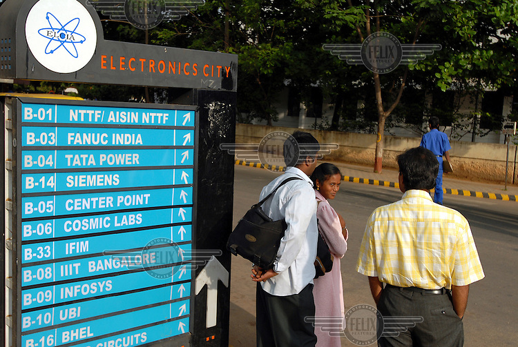 A small group of IT professionals talk at the entrance to 'Electronics City', an industrial complex dedicated to the IT and electronics industries. The 'Electronics City' complex, located ten miles outside Bangalore, has been hugely successful in attracting foreign investment and it is home to several multinational companies.