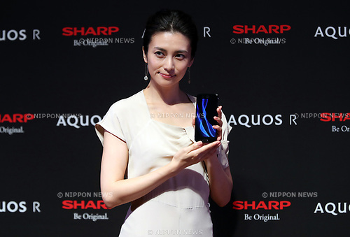 """July 4, 2017, Tokyo, Japan - Japanese actress Ko Shibasaki displays Japanese electronics giant Sharp's new smart phone """"Aquos R"""" at a promotional event in Tokyo on Tuesday, July 4, 2017. Sharp's flagship model Aquos R, which has a high definition IGZO display and a high resolution wide angle digital camera, will go on sale on July 7, the day of Tanabata festival.   (Photo by Yoshio Tsunoda/AFLO) LwX -ytd-"""