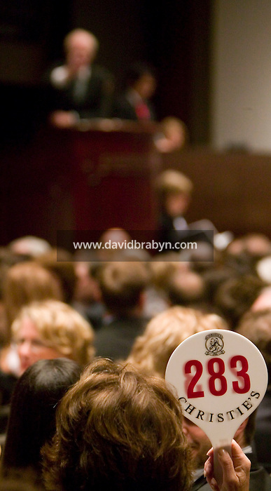 14 November 2006 - New York City, NY - A woman place a bid during a sale of Post-War and Contemporary Art at the Christie?s auction house in New York City, USA, 14 November 2006. The sale reached a total of $239,704,000.