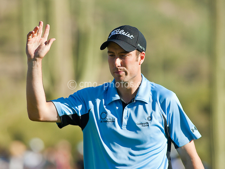 Feb 28, 2009; Marana, AZ, USA; Ross Fisher (ENG) acknowledges the crowd after making a putt on the 16th hole during the semifinal round of the World Golf Championships-Accenture Match Play Championship at the Ritz-Carlton Golf Club, Dove Mountain.