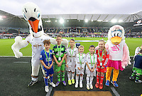 Children mascots with Cyril and Cybil the swans during the Barclays Premier League match between Swansea City and Leicester City at the Liberty Stadium, Swansea on December 05 2015