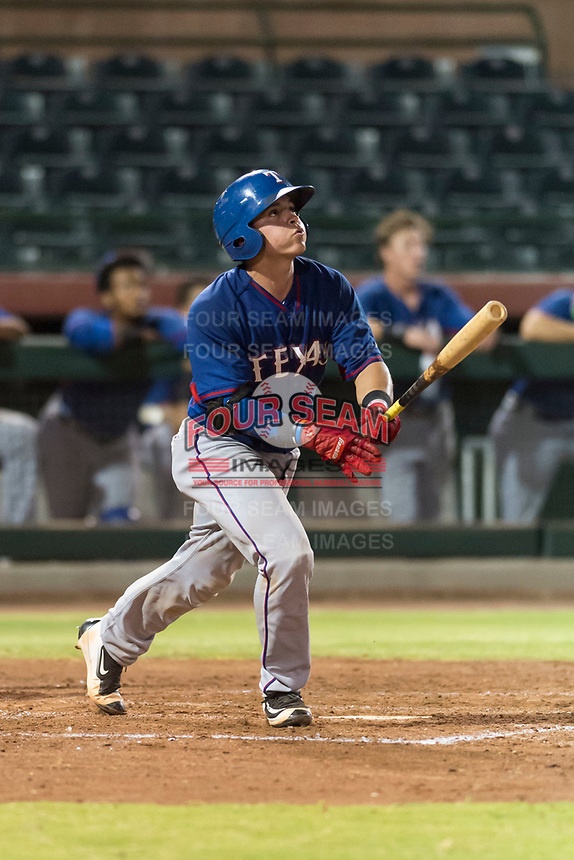 AZL Rangers catcher David Garcia (9) hits a home run during an Arizona League game against the AZL Giants Black at Scottsdale Stadium on August 4, 2018 in Scottsdale, Arizona. The AZL Giants Black defeated the AZL Rangers by a score of 6-3 in the second game of a doubleheader. (Zachary Lucy/Four Seam Images)