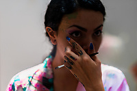 A Colombian webcam model, known as Sthephanie Mwarnert, applies the eye make-up before performing a live show, broadcasted online from her apartment in Medellín, Colombia, 5 March 2016. With the traditional adoration of female beauty in Colombia, together with rapidly developing telecommunications technologies, the millennial generations of Colombian girls have turned the city of Medellín during the past few years into a one of the world centers of webcam modelling, a booming interractive sex industry. Thousands of young women stream everyday via websites that allow the global viewers to personally interract with a model and to pay them for sexually related acts. Although the core of the show is always based on stripping, the crucial part of a cam girl's success is communication. Cam models who have the ability of light conversation, flirting and entertaining the viewer earn thousands of dollars a month and have moved far beyond the borders of sexuality. Sharing their whole lives in a constant interaction with their online clients, they have built regular relationships in the cyberspace.