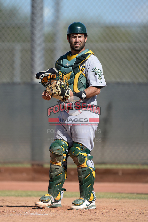 Oakland Athletics catcher Josh Miller (55) during an Instructional League game against the Milwaukee Brewers on October 10, 2013 at Maryvale Baseball Park Training Complex in Phoenix, Arizona.  (Mike Janes/Four Seam Images)