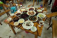 Table Of Dishes At A Hot Pot Restaurant On Cang Bai Lu in Chongqing, China.  © LAN
