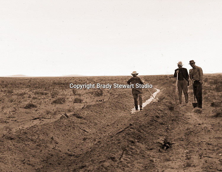 Jerome ID:  Neighbors helping the city slickers irrigate their land - 1911. Brady Stewart and three friends went to Idaho on a lark from 1909 thru early 1912. As part of the Mondell Homestead Act, they received a land grant of 160 acres north of the Snake River.  For 2 ½  years, Brady Stewart photographed the adventures of farming along with the spectacular landscapes.