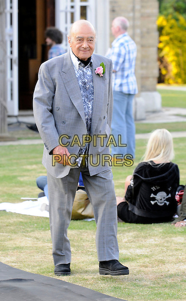 "MOHAMED AL FAYED.At ""Lawnfest"", an open air concert, West Heath School, Sevenoaks, Kent, England..June 25th, 2009.full length mohammed grey gray suit blue pattern shirt pink flower corsage .CAP/FIN.©Steve Finn/Capital Pictures."