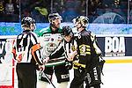 Stockholm 2014-03-21 Ishockey Kvalserien AIK - R&ouml;gle BK :  <br /> R&ouml;gles Andreas Lilja och AIK:s Martin Karlsson i ett br&aring;k under den tredje perioden<br /> (Foto: Kenta J&ouml;nsson) Nyckelord:  slagsm&aring;l br&aring;k fight fajt gruff