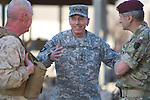 Mcc0027461 . Daily Telegraph..General David Petraeus , Commanding General of ISAF , flanked by (left) USMC Maj Gen Richard Mills and (right) Brigadier James Chiswell during his visit to FOB Shahzad where the 3 Para Battlegroup are based in the northern Nad e Ali district of Helmand Province...Helmand 29 November 2010
