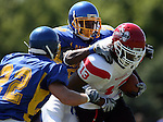 MADISON, SD - AUGUST 30: Anthony Saincilaire of Bacone College is brought down by Brandon Crawford of Dakota State University in the first quarter of their game Saturday afternoon at Trojan Field in Madison. (photo by Dave Eggen/Inertia)