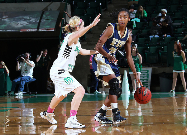 Denton, TX - FEBRUARY 9: Laura McCoy #4 of the University of North Texas Mean Green guards Jerica Coley #22 of the FIU Golden Panthers at the UNT Coliseum on February 9, 2013 in Denton, Texas. (Photo by Rick Yeatts)