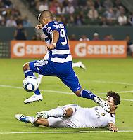 CARSON, CA – August 6, 2011: FC Dallas forward Maicon Santos (9) and LA Galaxy defender Omar Gonzalez (4) during the match between LA Galaxy and FC Dallas at the Home Depot Center in Carson, California. Final score LA Galaxy 3, FC Dallas 1.