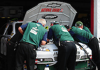Oct 3, 2008; Talladega, AL, USA; Crew members for NASCAR Sprint Cup Series driver Dale Earnhardt Jr (not pictured) look under the hood of the car after blowing an engine during practice for the Amp Energy 500 at the Talladega Superspeedway. Mandatory Credit: Mark J. Rebilas-