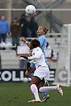 06 December 2009: North Carolina's Amber Brooks (behind) heads the ball over Stanford's Mariah Nogueira. The University of North Carolina Tar Heels defeated the Stanford University Cardinal 1-0 at Aggie Soccer Stadium in College Station, Texas in the NCAA Division I Women's College Cup Championship game.